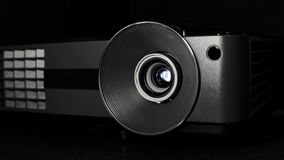 Digital film projector lens in action Royalty Free Stock Photography