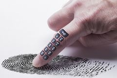 Digital finger print concept for online identity protection. Showing a finger with a keypad pressing on a finger print mark. White background stock images