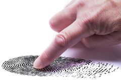 Digital finger print concept. For online identity protection showing a finger with a keypad pressing on a finger print mark. White background stock photos