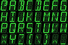 Digital font from capital letters on green alphanumeric LED display Stock Image