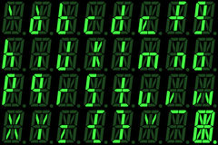 Digital font from small letters on green alphanumeric LED display Stock Photography