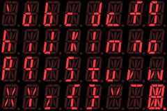 Digital font from small letters on red alphanumeric LED display Royalty Free Stock Photography