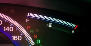 Digital Fuel Gas Meter on car panel stock image