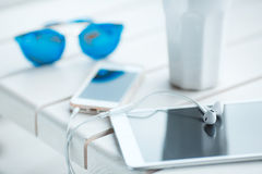 Digital gadget blue glasses and hot coffee Royalty Free Stock Photos