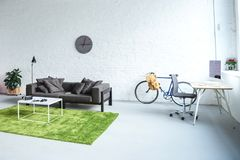 Digital gadgets in modern interior with grey sofa royalty free stock images