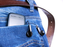 Digital generation. Metaphor about new jeans generation with digital equipment royalty free stock image