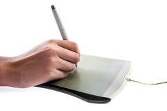 Digital grafisk minnestavla, penna och hand Arkivfoton