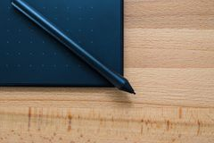 Digital graphic tablet and pen Royalty Free Stock Images