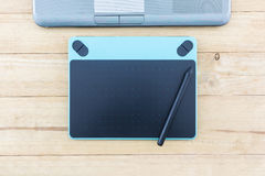 Digital graphic tablet and pen. Royalty Free Stock Photos