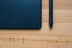 Digital graphic tablet and pen Royalty Free Stock Photo