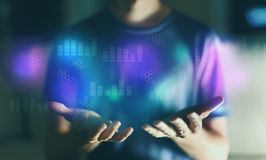 Digital graphs and hexagon grids with young man. In the night stock photos