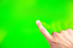 Digital green screen man hand. Young man types and slides on a computer screen. Digital screen with chroma key screen - green screen. Male hand Royalty Free Stock Photos