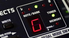 Digital Guitar Tuner. Digital guitar tuning display cycling through notes stock footage