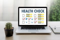 Digital HEALTH CHECK Concept working with computer interface as Stock Photography
