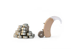 Digital hearing aid and its batteries royalty free stock photography