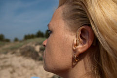 Digital hearing aids. On young woman ear Royalty Free Stock Photography