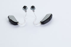 Digital hearing aids. Two digital hearing aids isolated on a white background Stock Images