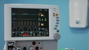 Digital heart monitor read out close up with lines graphing and numbers displayed of patient being measured. Digital heart monitor read out close up with lines stock video