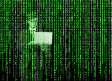 Digital hologram in a matrix style. A person with laptop is browsing data in the Internet. Green Stock Photography