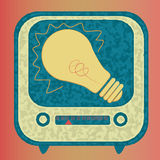 Digital idea. Yellow bulb coming out from a digital device showing an idea Stock Image