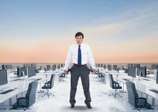 Digital image of businessman showing empty pockets while standing in office surrounded with sea agai. Digital composite of Digital image of businessman showing Royalty Free Stock Photo