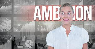 Digital image of businesswoman against ambition text and graphs. Digital composite of Digital image of businesswoman against ambition text and graphs Stock Photo
