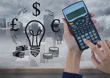 Digital image of cropped hands using calculator with various symbols Stock Photography