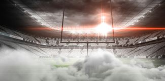 Digital image of goal post at American football stadium. With smoke Royalty Free Stock Images