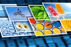 Digital imagery. Fast flow of digital photos over the keyboard of a laptop Stock Photos