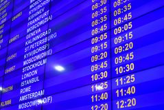 Digital information board with the schedule of flights at the airport. Digital information board with schedule of flights at the airport stock images