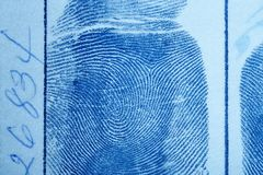 Digital ink fingerprint over a textured paper. Security control royalty free stock photos