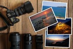 Digital kamera för DSLR, lins, exponering och bunt av foto på tappninggrungeträbakgrund royaltyfri foto