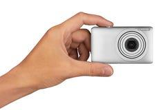 Digital kamera i hand Royaltyfria Bilder