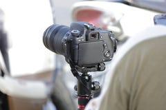 Digital kamera och tripod Arkivbilder