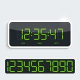 Digital klocka med den skinande plast- panelen tillägg Arkivbilder
