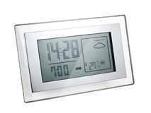 Digital LCD clock. Digital LCD radio controlled alarm clock, isolated Royalty Free Stock Images