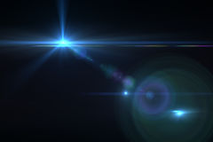 Digital lens flare. In black bacground horizontal frame Royalty Free Stock Photos