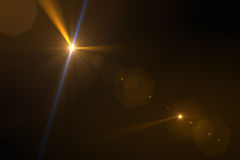 Digital lens flare. In black background horizontal frame warm Royalty Free Stock Images