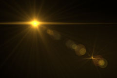 Digital lens flare. In black background horizontal frame warm Stock Photos