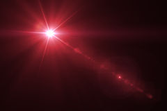 Digital lens flare. In black background horizontal frame warm Royalty Free Stock Photography
