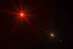 Digital lens flare. In black background horizontal frame warm Royalty Free Stock Image