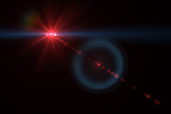 Digital lens flare. In black background horizontal frame warm Stock Photography