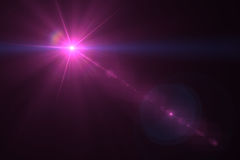 Digital lens flare. In black background horizontal frame warm Royalty Free Stock Photos