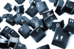 Digital letters. Pieces from a keyboard spread out, on white background Royalty Free Stock Photo