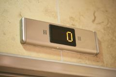 Old shower in a hotel detail. Digital lift number display 0 Royalty Free Stock Images