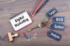 Digital Marketing concept. The key to success on a wooden office desk.  Stock Photo