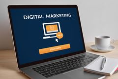 Digital marketing concept on modern laptop screen. Digital marketing concept on modern laptop computer screen on wooden table stock images