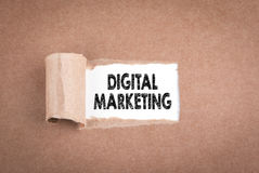 Digital Marketing. Inscription in window of torn paper stock photos