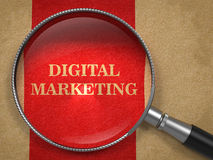 Digital Marketing Through Magnifying Glass Royalty Free Stock Image