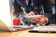Digital marketing media in virtual screen with mobile phone. Businessman hand using laptop, tablet and smartphone in office. Digital marketing media mobile app royalty free stock photos